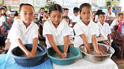 Children washing hands, training after Typhoon Bopha