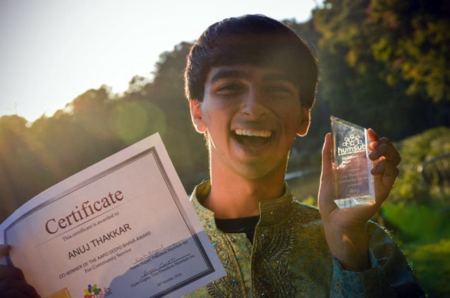 Anuj with his community service award for his Raleigh Walk-a-Thon