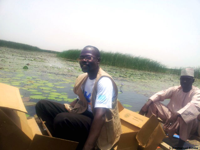 Ibrahim with the canoe he hired to deliver lifesaving supplies. Photo: E. Bimba