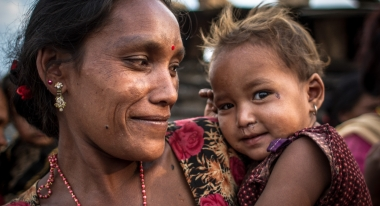 Bimala Nepali holds her youngest daughter, Roshina, in the ward of Gunsha. Her house as well as the other 14 homes of her village were destroyed in the earthquake. Credit: Daniel Burgui Iguzkiza for Action Against Hunger