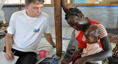 An ACF worker checks on Ivorians displaced. Photo: ACF-Ivory Coast