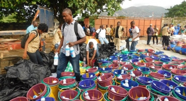 Action Against Hunger is delivering emergency hygiene kits and supplies of clean water to communities devastated by flooding in Freetown, Sierra Lone. Photo: Action Against Hunger, Freetown, Sierra Leone