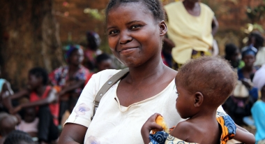 A mother and her child from our Nutritional Gardens program in Bangui, Central African Republic. Photo: L. Grosjean