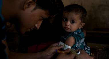 Child being tested for malnutrition.