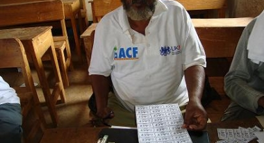 ACF Worker during food distribution in Elbon, Somalia
