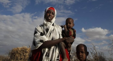 Mother and children in a displacement camp in Somalia. Credit: Eric Dessons for Action Against Hunger