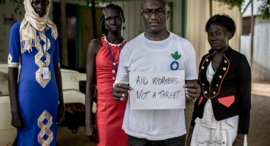 Members of Action Against Hunger's emergency nutrition team in South Sudan: Angela Abuk Magok, Community Mobilizer; Asunta Nyanut Garang, Community Mobilizer; Sebit Sebit Ahmed, Nutrition Program Manager; Adut Atak Bulo, Nutrition Health Promoter. South Sudan is the world's most violent context for aid workers. Photo: Guy Calaf and Lys Arango for Action Against Hunger, South Sudan.