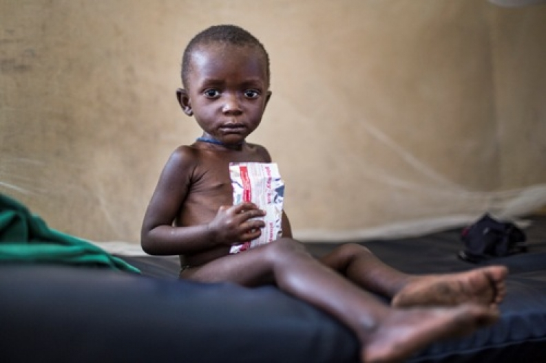 Child with therapeutic food in Kivu, DR Congo. Credit: J. Assenbrenerova