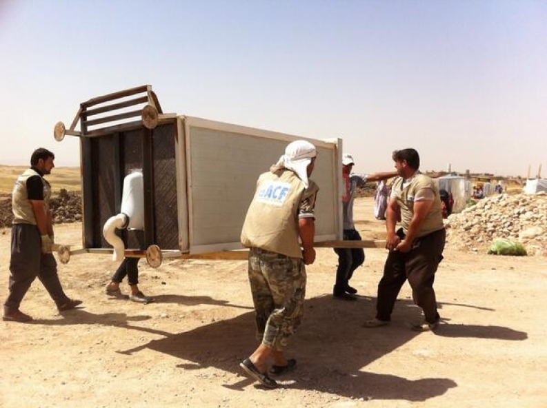 Our teams and community members install a latrine in Garmawa camp. Photo: ACF-Kurdistan