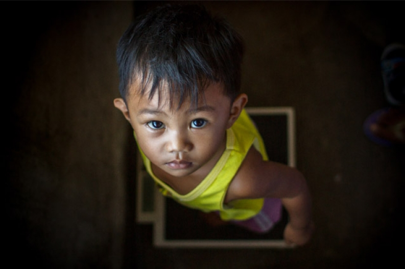 A boy is screened for malnutrition as a part of relief efforts in Iloilo province. Photo: ACF-Philippines, D. Burgui