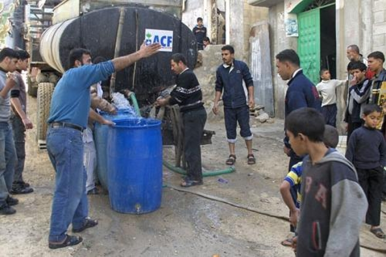 Action Against Hunger trucks clean water into the Palestinian Territories.