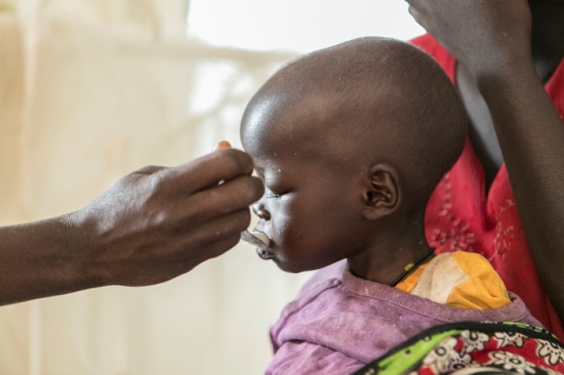 A child gets fed therapeutic milk in West Pokot, Kenya. Credit: S. Hauenstein-Swan