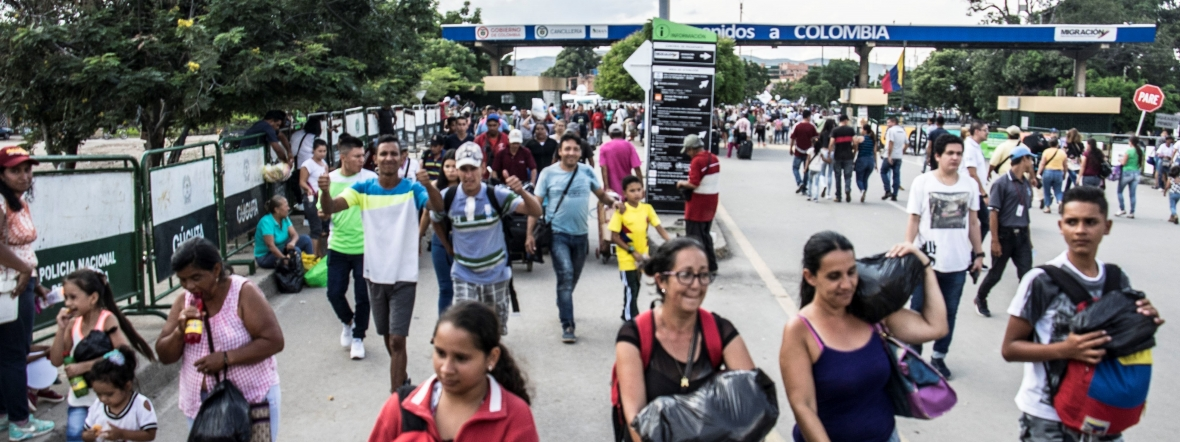 Migrants from Venezuela arrive at the border with Colombia.