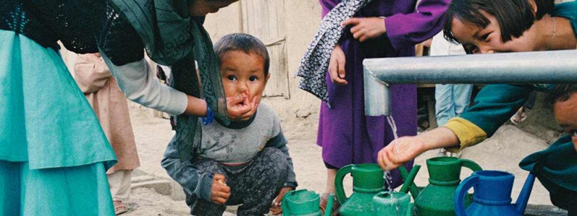 A family in Afghanistan gets fresh water from a well near their home.