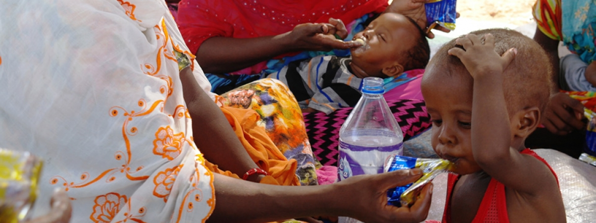 Mothers in Djibouti feed their malnourished children ready-to-use therapeutic food.