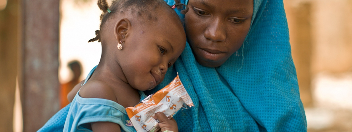 A malnourished girl in Niger receives nutrition treatment during the Sahel food crisis.