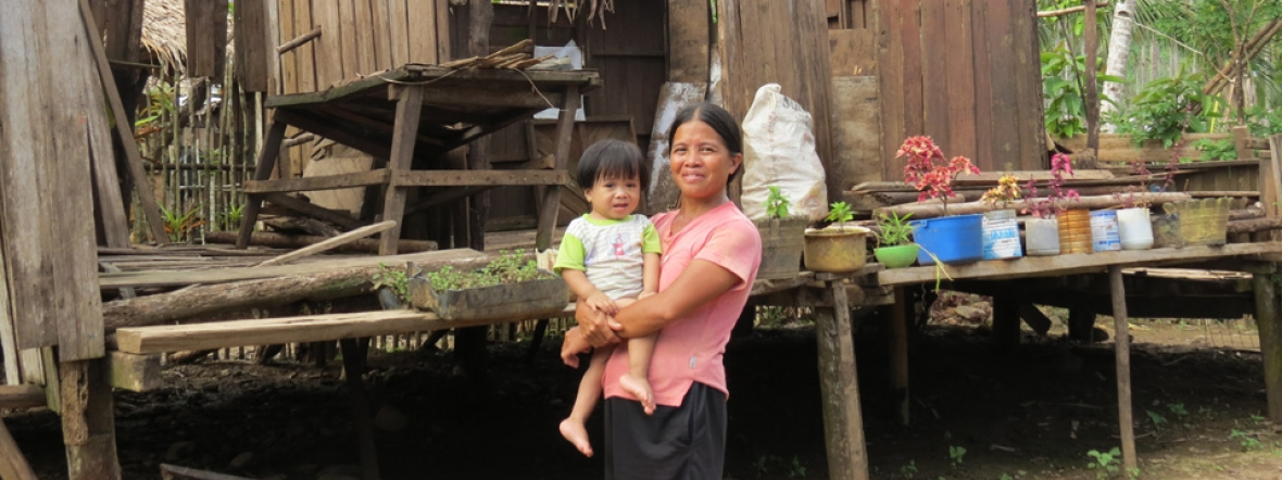 Action Against Hunger helps families like this one recover after a typhoon hit the Philippines.