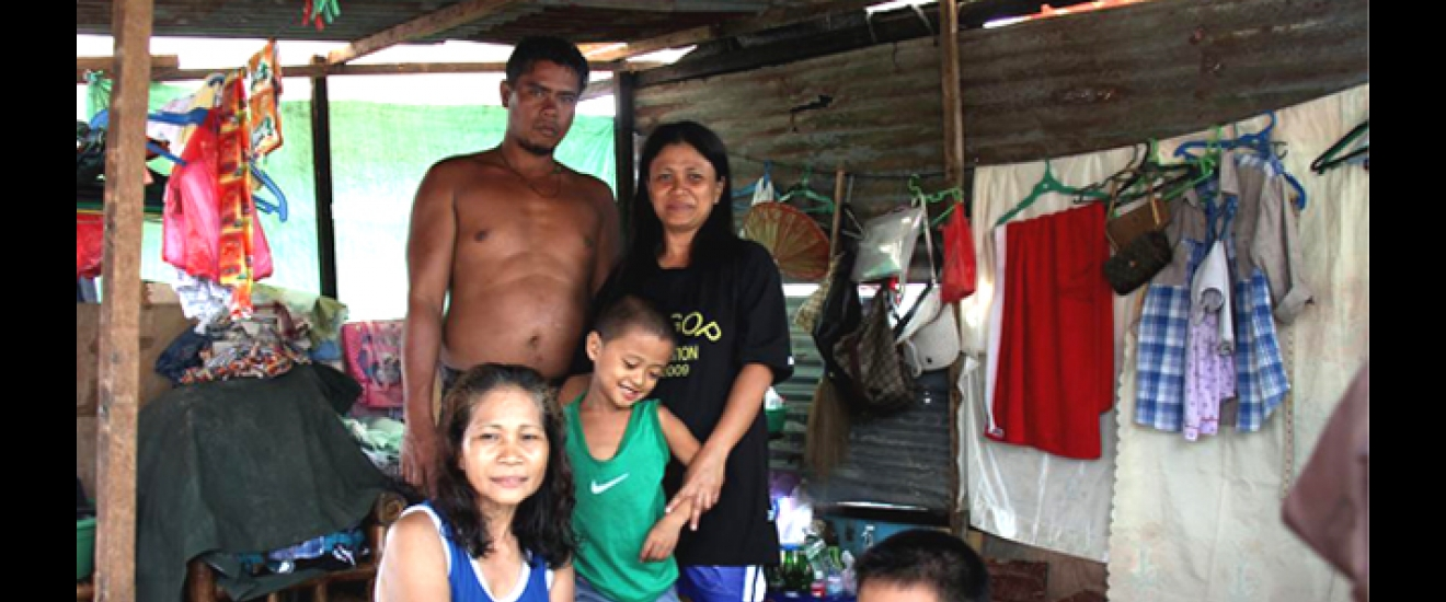 Geronima and her family in their shelter in Tanawan. Photo: ACF-Philippines, L. Grosjean