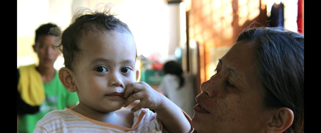 Condora Acosta with her nephew, 20-month-old Yen Lestor, at their community church. Photo: ACF-Philippines, L. Grosjean