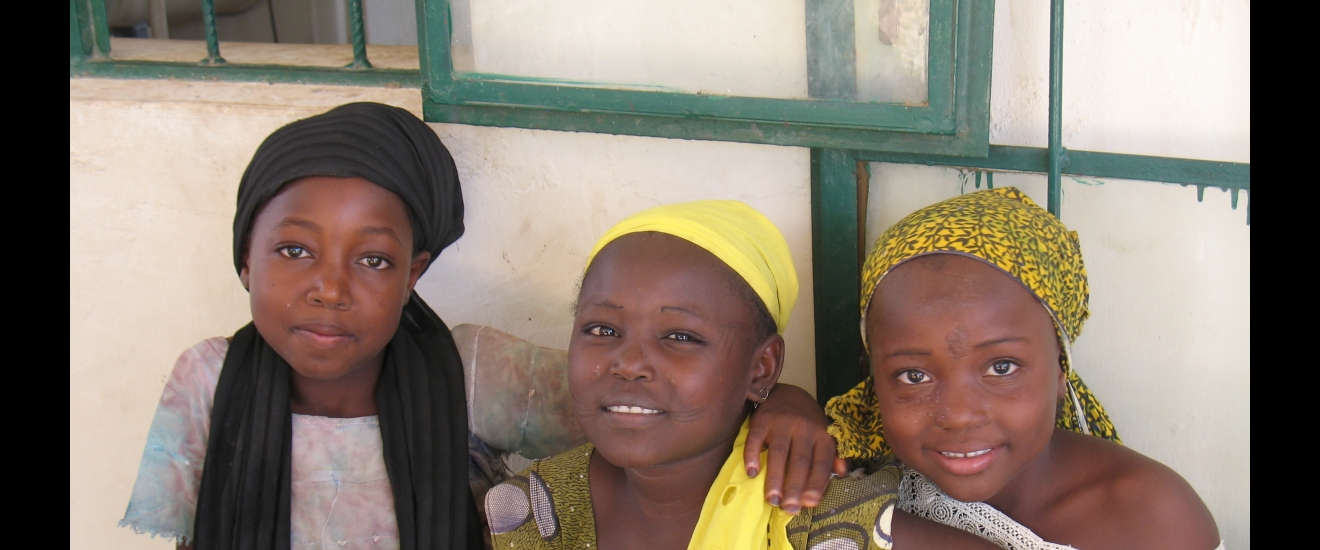 Three Nigerian girls in Jajere smile for the camera