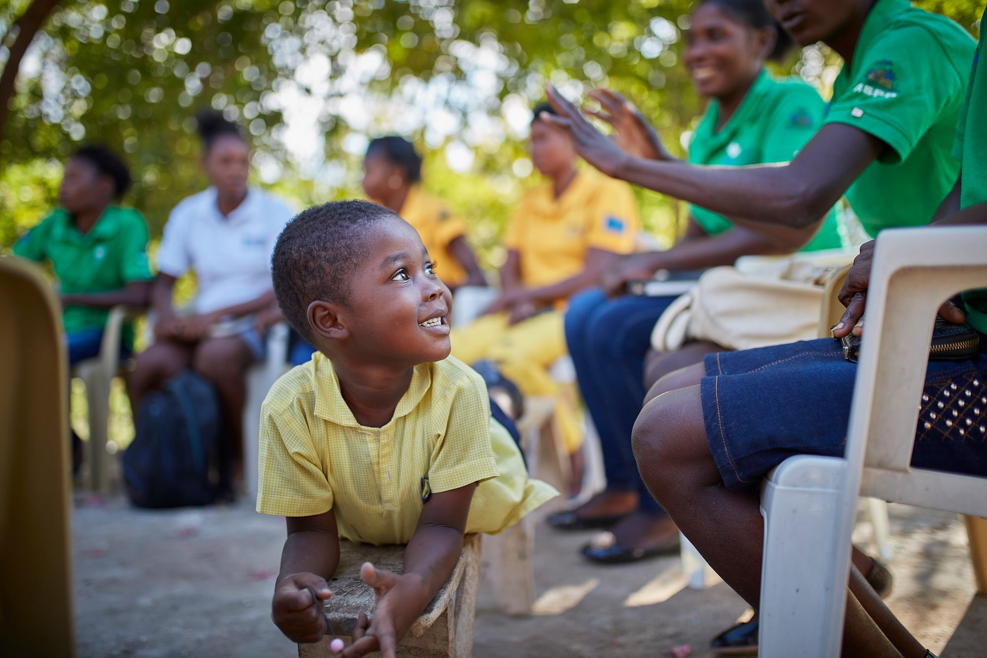 This child's mother is participating in training to become a lead nutrition volunteer in one of Action Against Hunger's community mother-to-mother support groups.