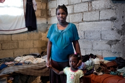 Kemlie lost her home in the earthquake and lives in a camp with her daughter. Photo: ACF-Haiti, G. Turine