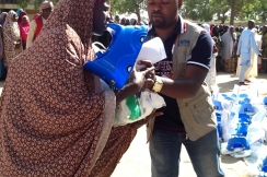 A member of our team distributes hygiene kits to families in the city of Maiduguri, Borno state. Credit: Action Against Hunger