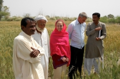 Kendra with farmers in Pakistan.