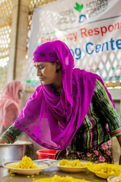 Serving hot meals at one of Action Against Hunger's feeding center. Every day, our mobile teams are delivering more than 83,000 hot meals to Rohingya refugees in camps and other locations. Photo: Kathleen Prior for Action Against Hunger, Bangladesh