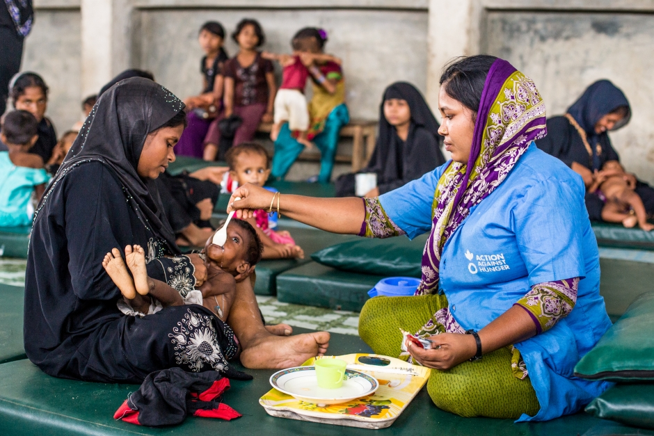 Senu Ara Begum is a Rohingya refugee. Here, her two year old, Shahini Bibi receives food and a health check up. Photo: Kathleen Prior for Action Against Hunger, Bangladesh