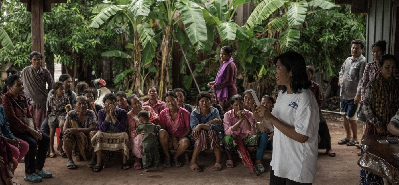 Dara, Action Against Hunger community mobilizer, conducts a session to set up a rice bank in the village of Sraem Tgong, Preah Vihear province, Cambodia