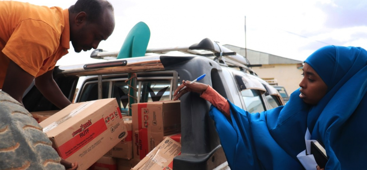 Salatha checks a truck full of lifesaving nutrition treatment before it heads out to the field.
