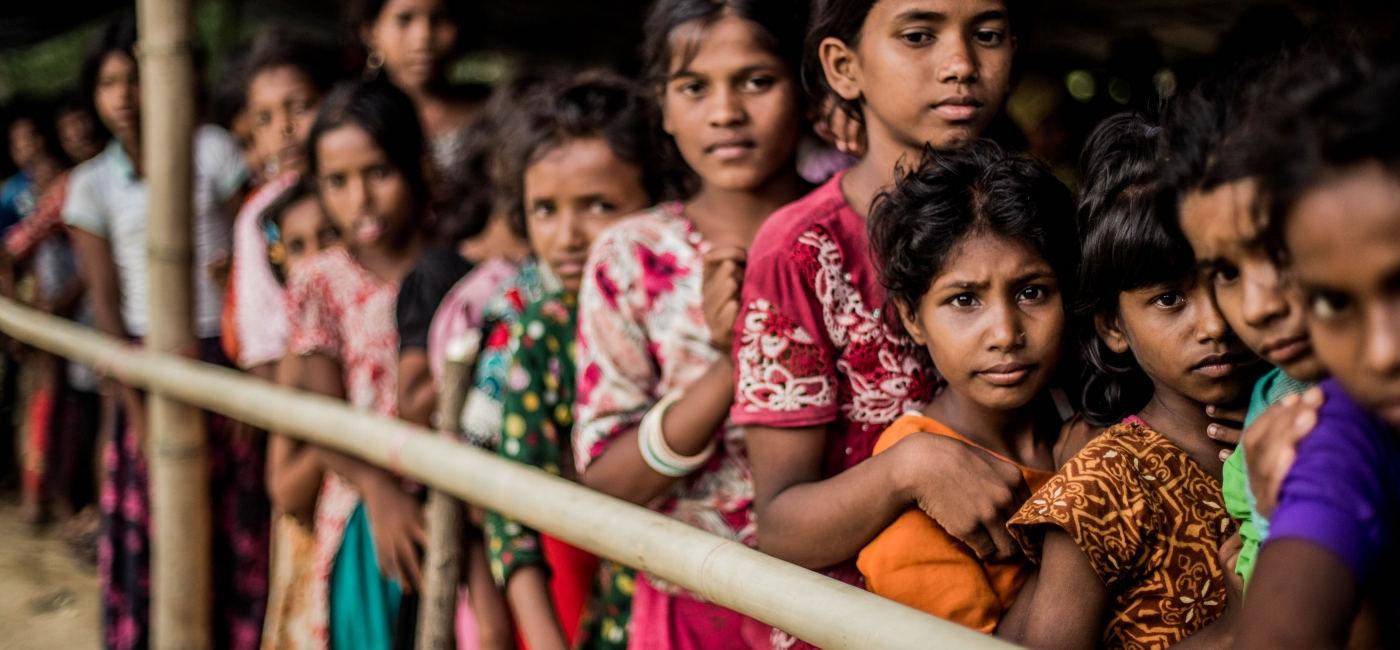 Child refugees in Bangladesh line up at a recent food distribution.