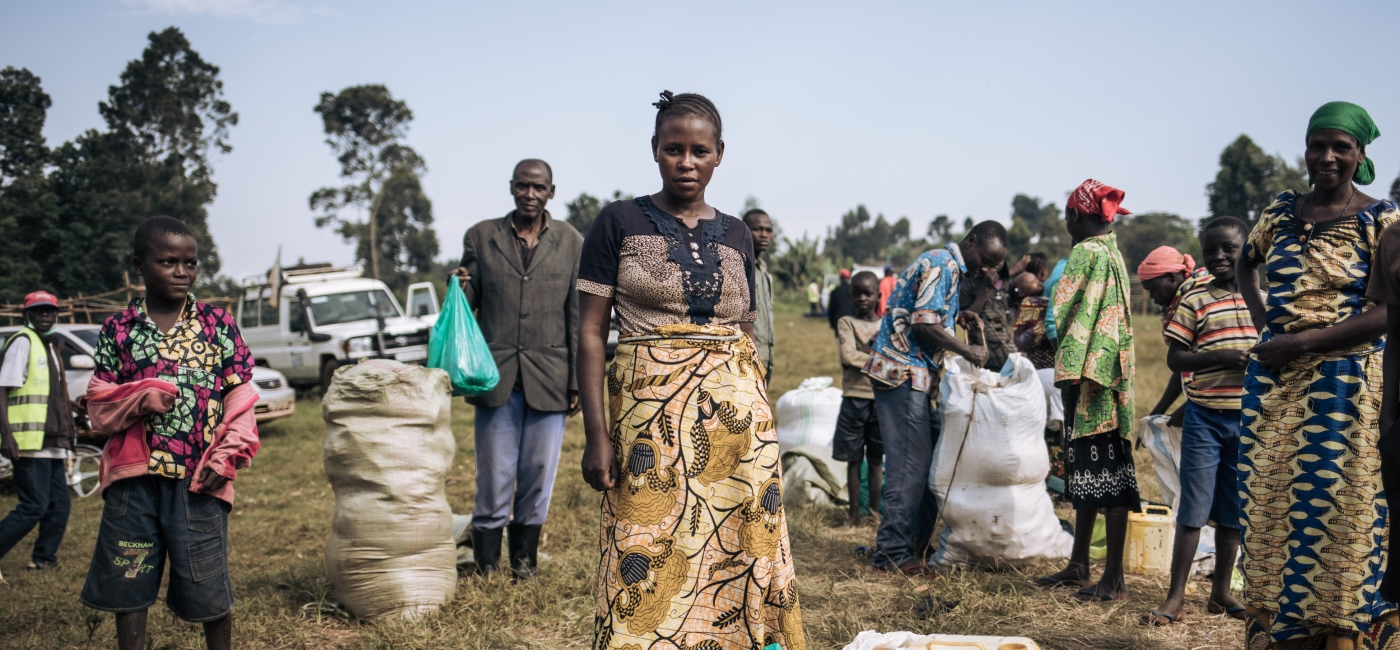 Cécile Tabo Mapamadjo, 28, shops for her family with support from Action Against Hunger at the Largu Food Market, in Ituri, eastern Democratic Republic of Congo.