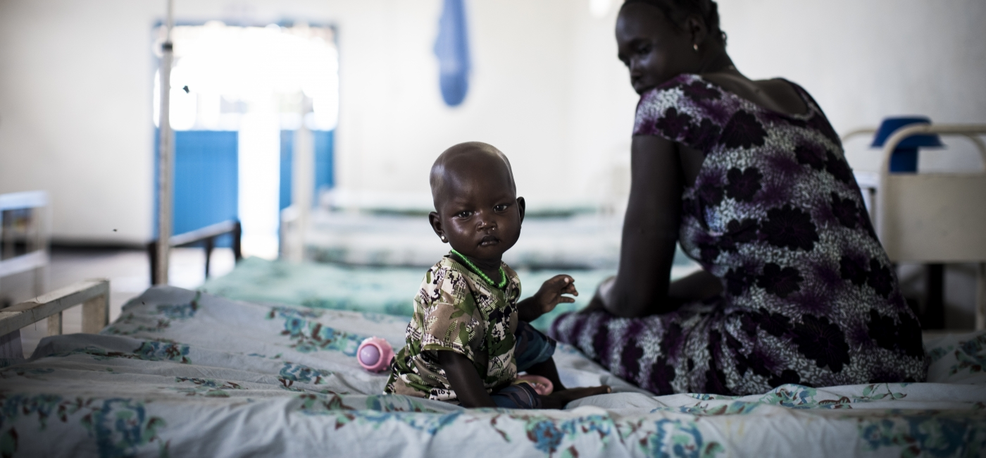 A malnourished child and her mother sit inside one of Action Against Hunger's nutrition centers in Ethiopia.