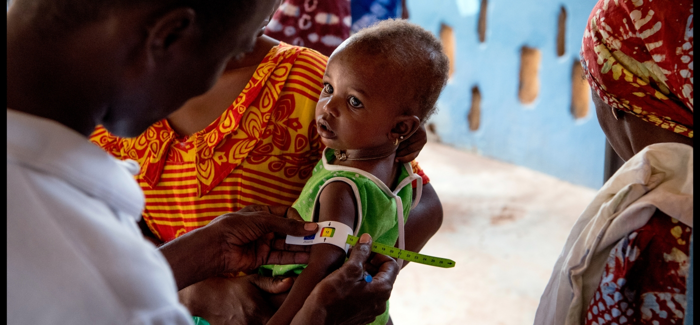 Young child being assessed for malnutrition by Action Against Hunger