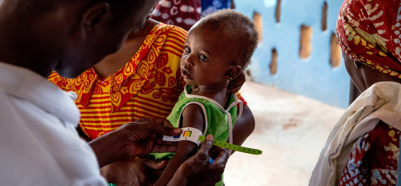 Young child being assessed for malnutrition.