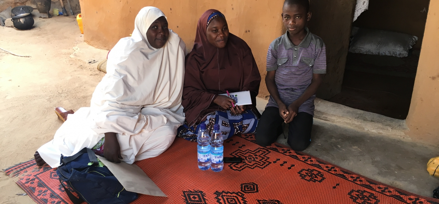 From left to right: Yajelo, Bulama's oldest sister and guardian; Fatima, Action Against Hunger Nutrition Officer; and Bulama, Community Health Volunteer.