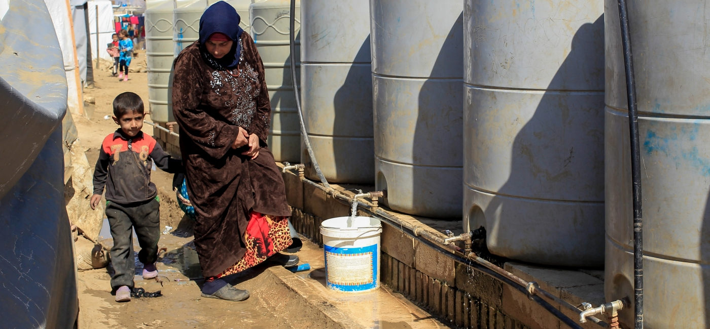 Action Against Hunger is helping displaced Syrians and Syrian refugees access clean water.