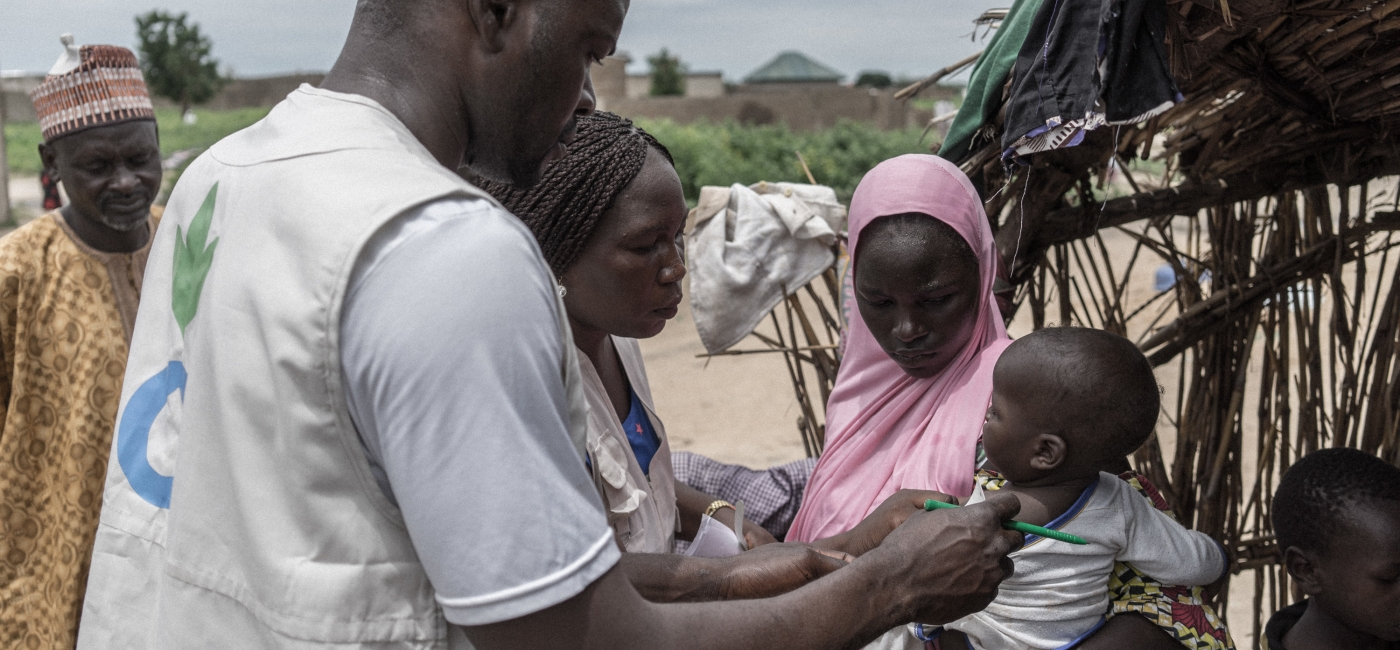 Action Against Hunger staff coordinate a mobile clinic for community members in Monguno, Borno State, Nigeria.