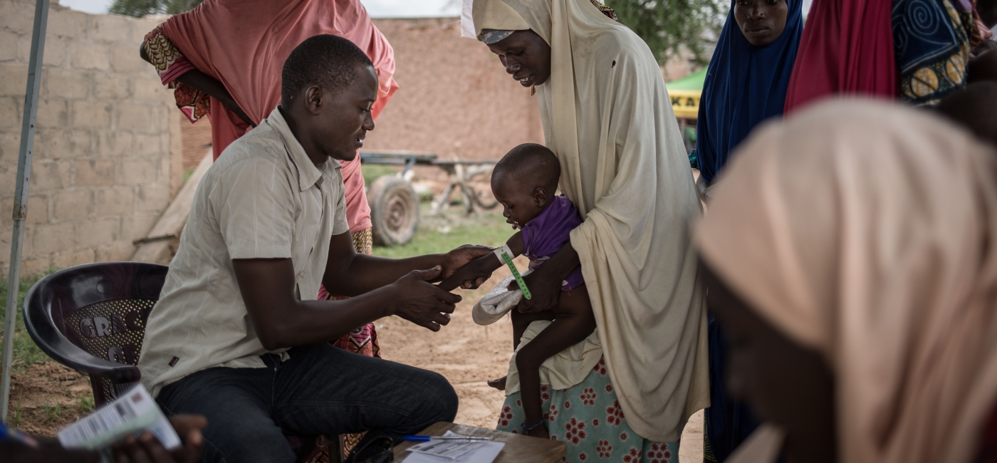 A child is screened for malnutrition in Niger, 2018.