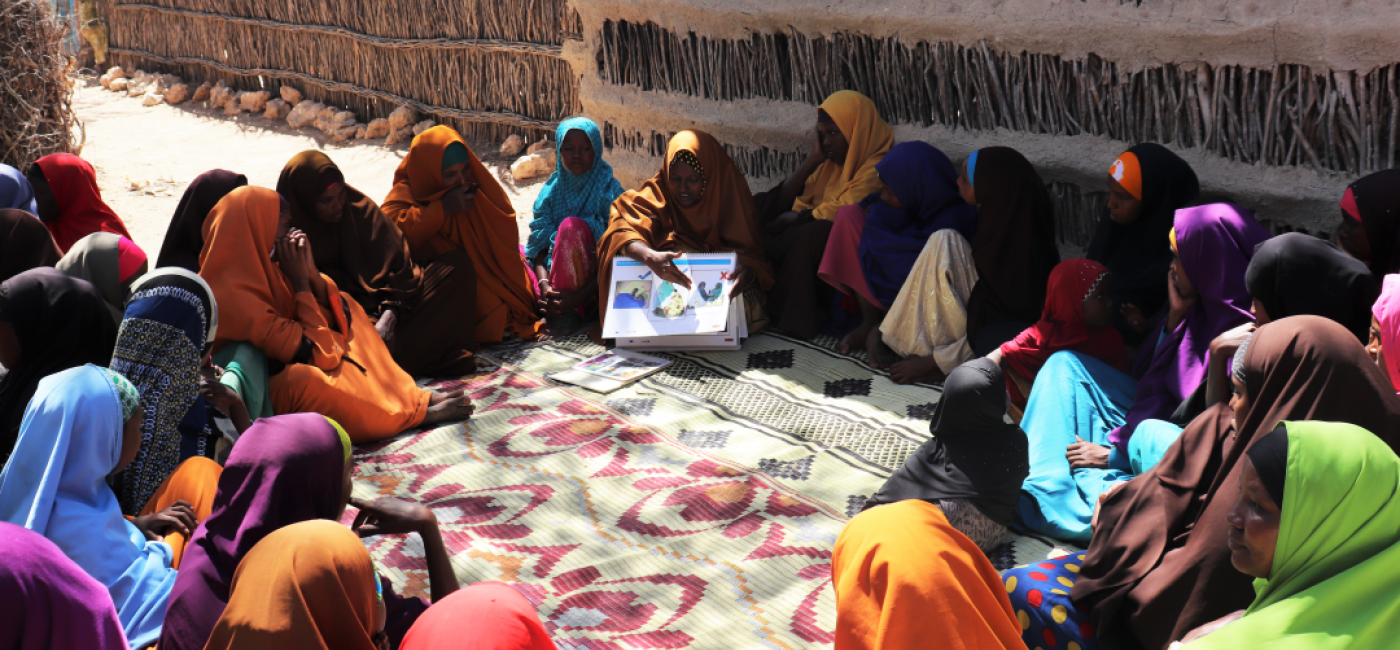 Community health worker Rahma Ali leads a group session with mothers in her village.