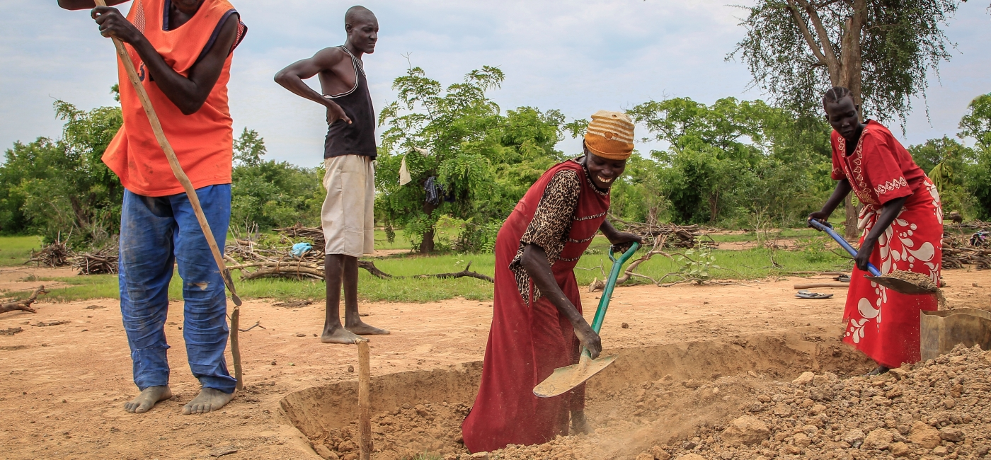 Together with humanitarian workers, local community members in Yargot, South Sudan, earn income as they construct a new road from their community to the nearest school -- part of Action Against Hunger's Food Security and Livelihoods program.