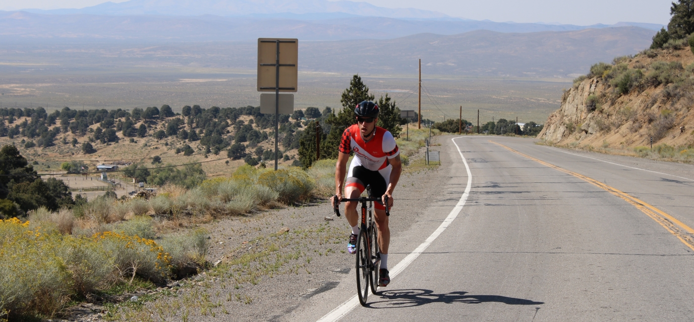 A person cycling to raise money for Action Against Hunger
