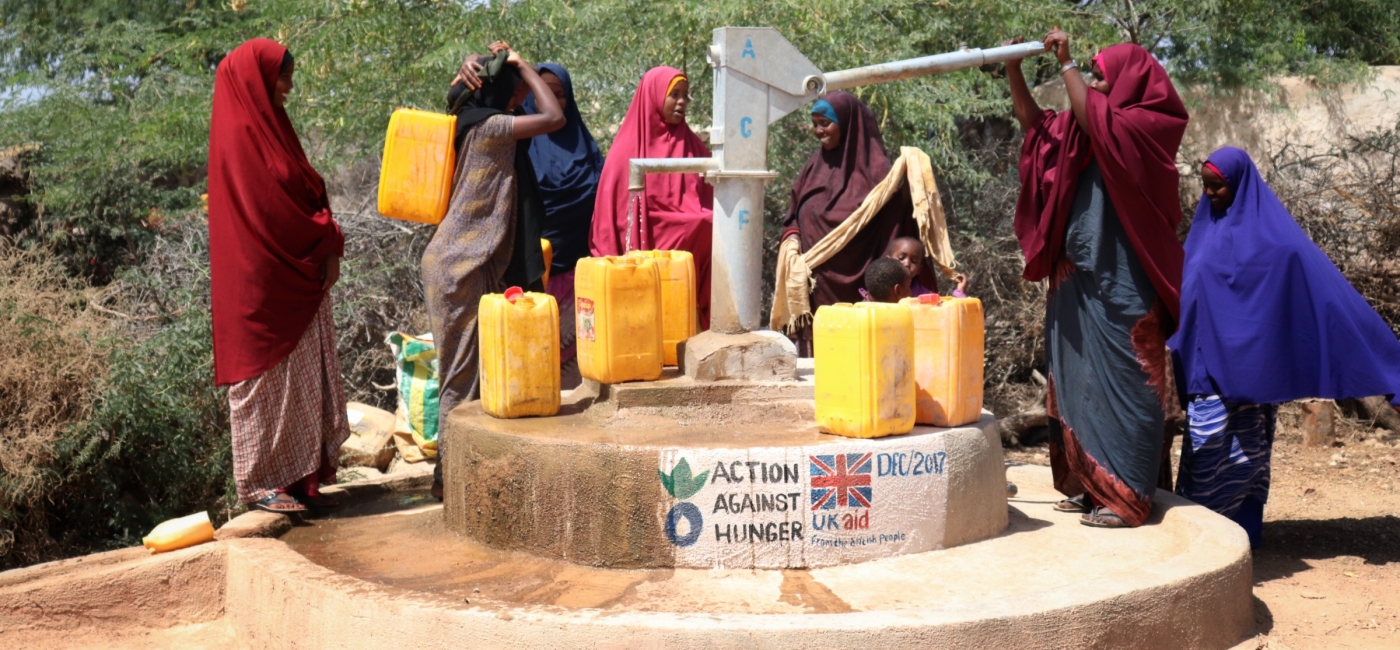 In Hudur, Somalia, women collect water at a well rehabilitated by Action Against Hunger.