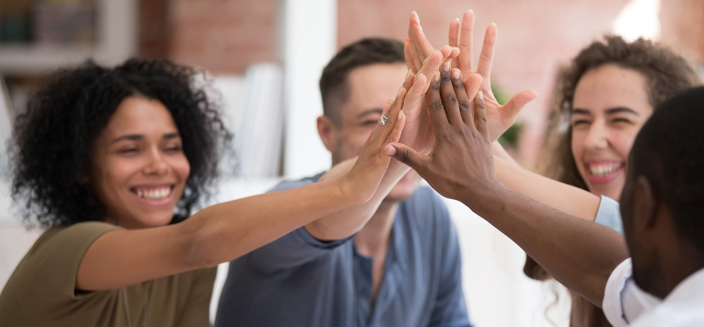 Colleagues giving each other a high five
