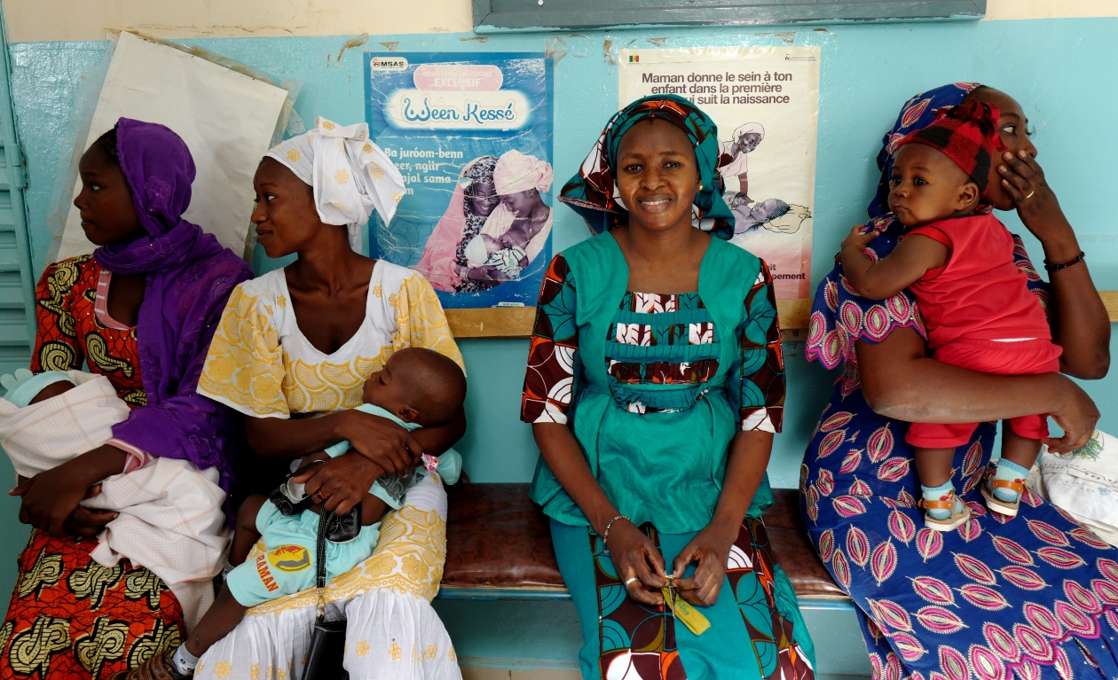 Midwife Madame Seck (middle, in green) with mothers at the health center in Matam, Senegal.