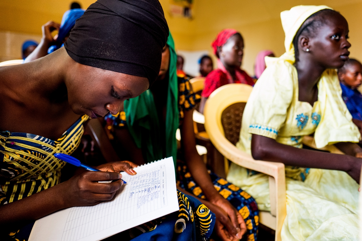 Young women sign in at family planning lesson taught by peer educators at a youth advice center in Matam, Senegal.