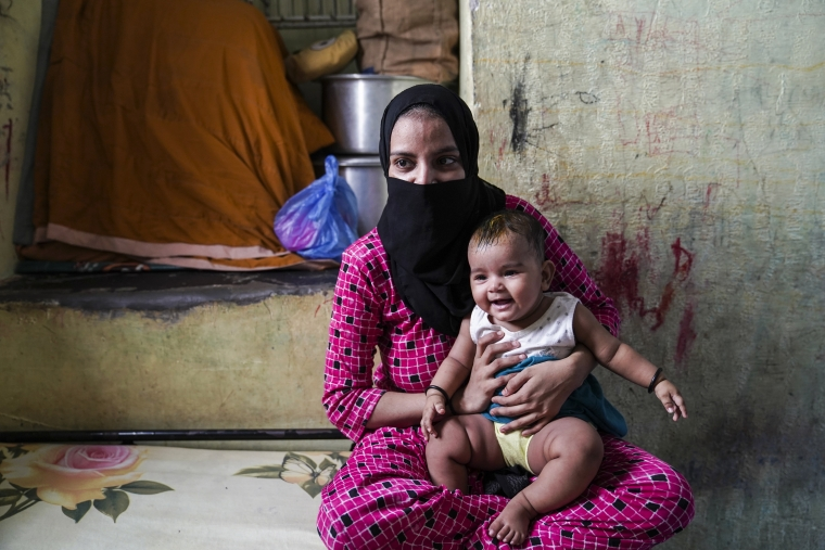 Asma with her six-month-old daughter Aayat at her family's home.