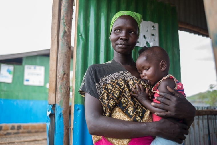 Nyalat, a South Sudanese refugee in Ethiopia, breastfeeds her young son.